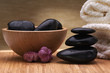 spa towel. black balanced hot stones