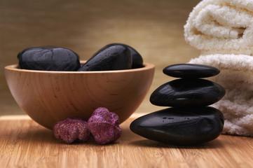 spa towel. black balanced hot stones
