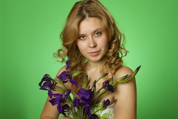 Attractive girl hugging a bouquet of iris