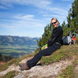 female hiker have a break on the hiking trail in the Alps