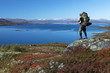 long distance Hiker over a lake in the north of sweden