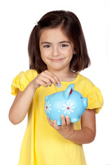 Brunette little girl with a blue moneybox