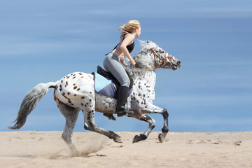 Girl and spotted horse