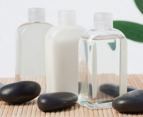 Black stones and massage oil