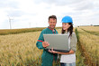 farmer and engineer wind in wheat fields