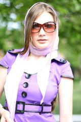 Beautiful girl in violet dress