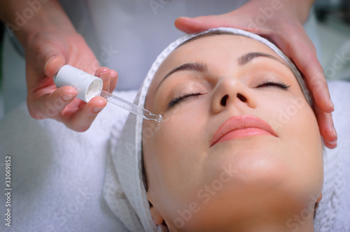 pretty woman getting special skin treatment at beauty salon