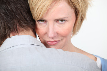 Woman looking over man's shoulders