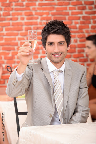 Man raising glass of champagne