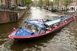 Motor boat in Amsterdam Channel, Netherlands