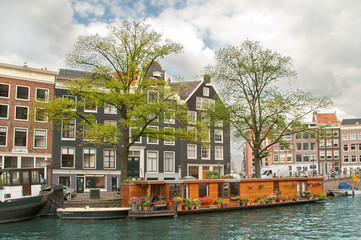 House boat in Amsterdam channel, Netherlands