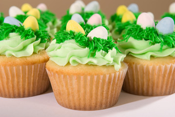 Many Easter Cupcakes with Candy Eggs