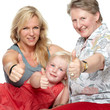 Portrait of a smiling family showing thumps up