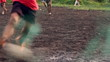 Mud soccer in slow motion