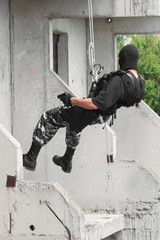 Armed soldier in black mask capturing the building