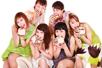 Group of  young people with cake.