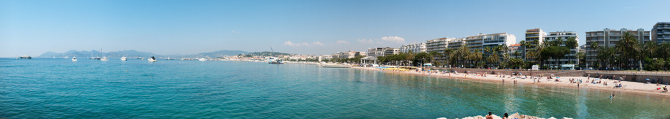 Sunshine beach and turquoise water in Cannes, France.