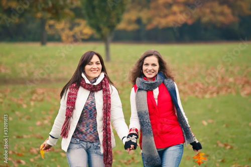 Two pretty girls having fun in a park