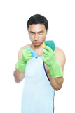Cleaning man in apron holding cleaning sponge and duster poster