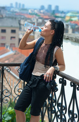 woman tourist drinks water