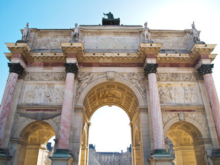 behind of Arc de Triomphe du Carrousel with Louvre museum