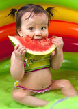 Baby girl in wading pool poster