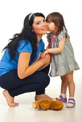 Little daughter tells secret to mother