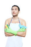 man in apron with cleaning sponge and duster looking up poster