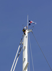 Man at the top of a mast