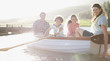 Family in rowboat on lake