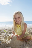 Girl making sandcastle on beach
