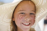 Close up of girl wearing sun hat