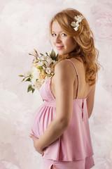 Pregnant woman smiling at camera.