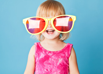 A little girl with a huge sunglasses