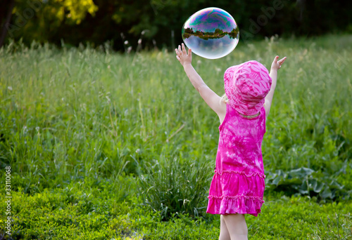 A girl is blowing bubbles