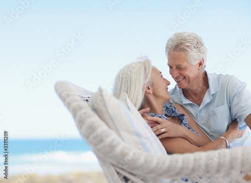 Senior couple hugging on patio