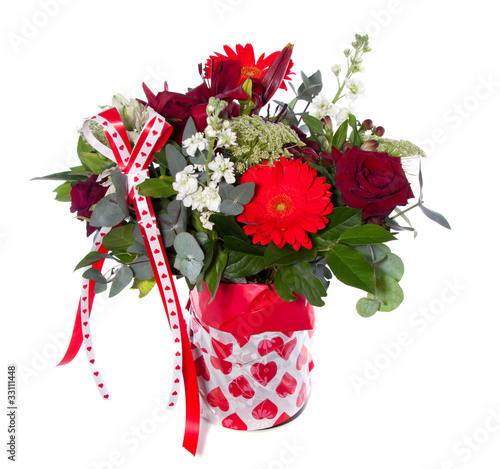 a mixed bouquet with red and white flowers in a flower pot isola