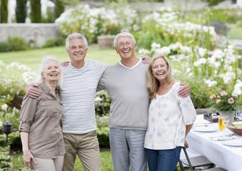 Senior couples at table in garden