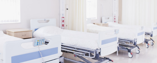 Hospital beds in empty room