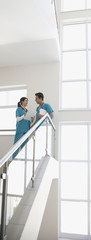 Nurses talking on stairs