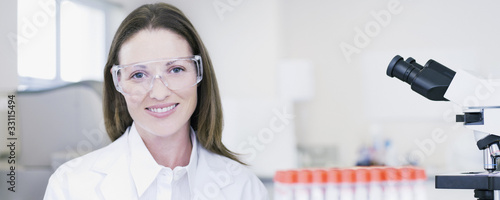 Portrait of scientist wearing goggles in laboratory