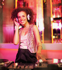 Female DJ in nightclub
