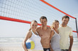 Friends on beach volleyball court