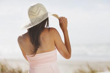 Woman in sun hat on beach