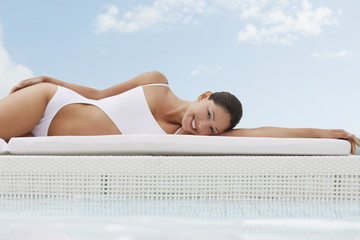 Woman laying poolside