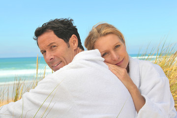 Couple on the dunes in towelling robes