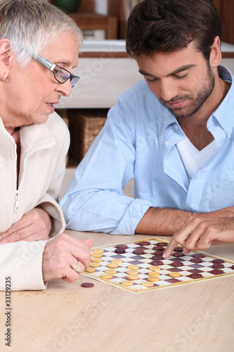 Mother and son playing checkers