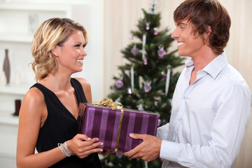 Couple with a Christmas present