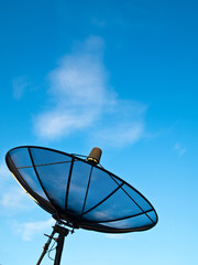 Satellite dish under blue sky background (Vertical)