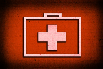 Suitcase for healing symbol on red paper background